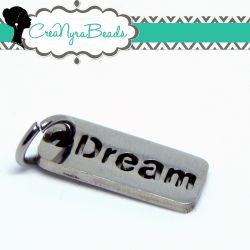 Ciondolo acciaio inox Targhetta Scritta Dream intagliata 17x7mm